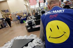 Clayton Fackler, 72, works at the checkout at the 2,000 square foot Wal-Mart ...