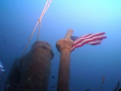 Underwater image of the USS Lagarto and the American flag. Missing for more than 60 years, Lagarto and her crew of 86 men vanished during war patrol in the Pacific in 1945.