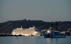 The stranded Carnival Splendor cruise ship is towed to San Diego Harbor by tu...