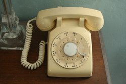 The dial phone that rings like a school bell next to the author's bed