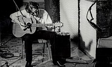John Lennon playing the guitar