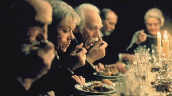 "The dinner guests in the midst of transformation in ""Babette's Feast."""