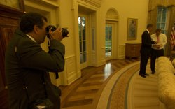 Pete Souza photographs President Obama and Press Secretary Robert Gibbs in the Oval Office.