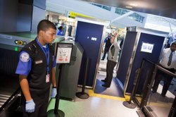 TSA officers give a demonstration of the first Advanced Imaging Technology un...