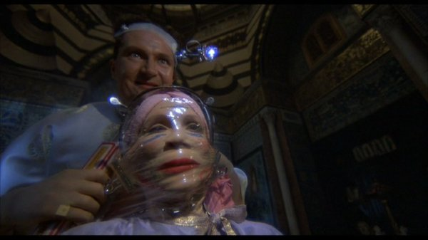 "Jim Broadbent and Katherine Helmond in Terry Gilliam's ""Brazil."""