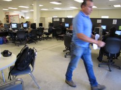 A client walks out of the county's unemployment office after searching for jobs online.