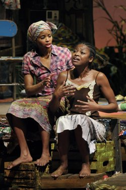 "Carla Duren (left) as ""Sophie"" and Pascale Armand as ""Salima"" in La Jolla Playhouse's production of RUINED, by Lynn Nottage. photo by Kevin Berne."