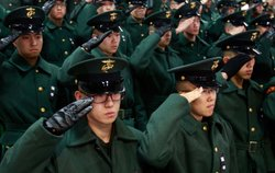 South Korean marines salute during a funeral service for the marines who were...