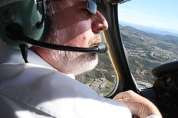 San Diego County Airports Director Peter Drinkwater flies his small prop plane toward a landing at McClellan-Palomar Airport.