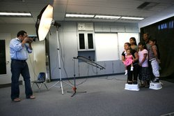 One of the volunteer photographers photographs a family during last year's Help-Portrait SD event.
