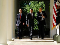 President Obama walks at the White House with presidential debt commission co...