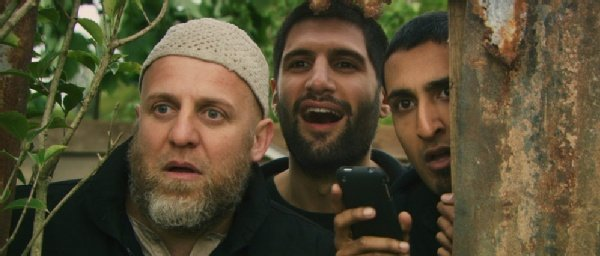 "Nigel Lindsay (front) is Barry in ""Four Lions."""