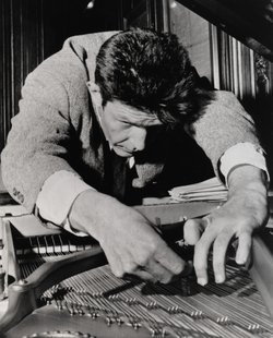 Composer John Cage playing prepared piano.