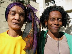 Denise Saunders (right), mother of Micheal Taylor, and Tracey Swafford (left)...