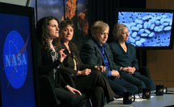 Felisa Wolfe-Simon, NASA astrobiology research fellow, speaks while flanked b...