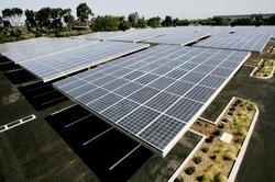 Solar panels sit above the Solar Grove parking lot at the Kyocera Plant in Sa...