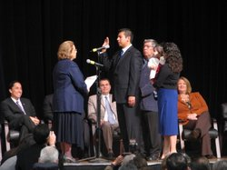 Newly elected Democratic Councilman David Alvarez is sworn into office while his wife and baby daughter watch on Dec. 6, 2010.