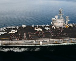 USS Nimitz Sailors and their families and friends spell out