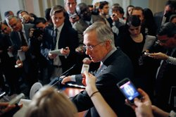 Senate Majority Leader Harry Reid (D-NV) talks with reporters after a Democra...