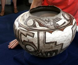 In Milwaukee, Wisconsin, a lady brings in a rare circa 1885 Zuni Indian pot, ...