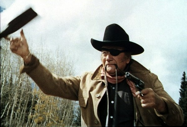 "The one-eyed fat man makes his stand... John Wayne doing a summation of his career in ""True Grit"" (1969)."