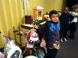 Anthony is a first-grader at Logan Elementary School who got a bike from the ...