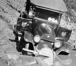 "Photo of Gus Holm's car along the ""highway."" He came from Cody, Wyoming, and ..."