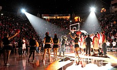 A packed Viejas Arena is filled with students and fans cheering on the San Diego State University's basketball team.
