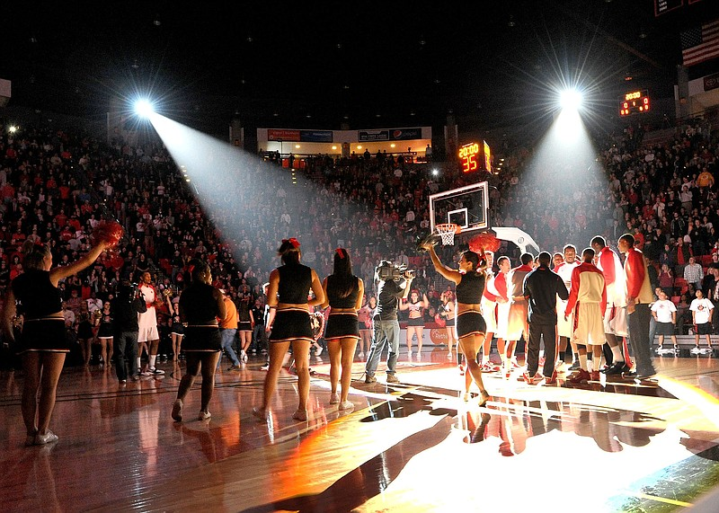 A packed Viejas Arena is filled with students and fans cheering on the San Di...