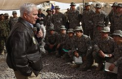 U.S. Secretary of Defense Robert Gates (L) addresses U.S. troops while visiting Forward Operating Base Howz-E-Madad in Kandahar Province December 8, 2010 in Afghanistan. Gates is visiting U.S. soldiers in different operational areas of Afghanistan during his visit.