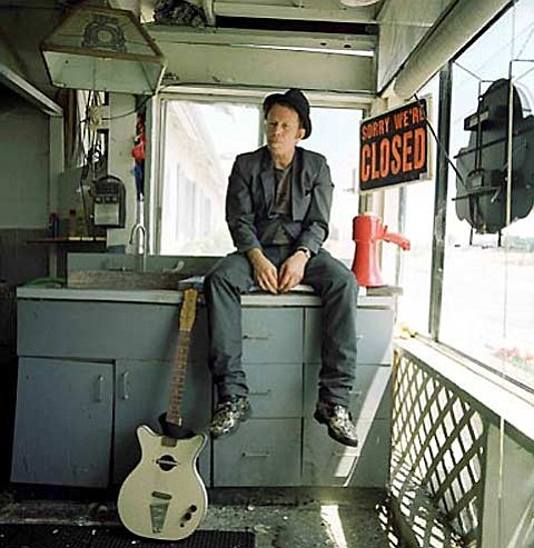 Tom Waits, posing like one of the down and out characters about whi... ()