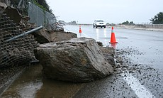 A rock slide slows traffic on Navajo Road in the San Carlos neighborhood of S...
