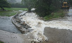 A rushing channel is created as storm drains overflow and can no longer handl...