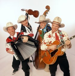 Members of the band, or rather the harmonizing cowboy quartet, Riders in the ...