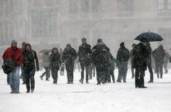 People walk through the afternoon snow in Manhattan's Union Square December 2...