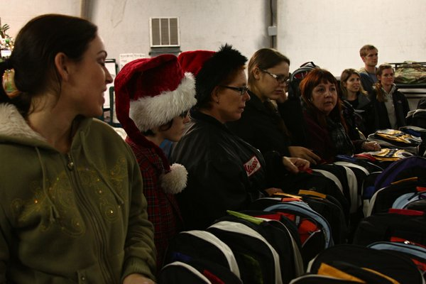 """Flickr member """"Born&Raised National City"""" took this picture of members from Girls Think Tank and Embrace, two non-profit organizations, who volunteered their time to help veterans in San Diego. They passed out """"Winter Survival Packs"""" and hot food to veterans."""