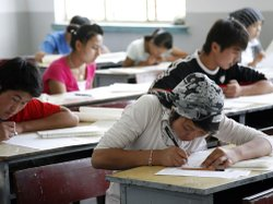Students take China's national college entrance exam, the gaokao, last year in Hami, Xinjiang Uygur Autonomous Region. Educational experts say the all-important test is at the heart of the Chinese educational system's emphasis on rote learning and memorization.