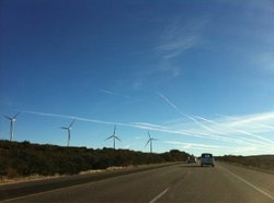 Wind power farms have been popping along the old power line throughout the Im...