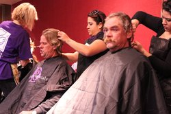 Homeless men get haircuts at Project Homeless Connect in San Diego's Golden H...