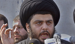 Iraqi radical Shiite cleric Moqtada al-Sadr speaks during a press conference ...