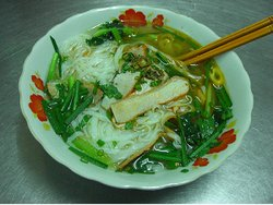 A delicious bowl of pork pho in a back street in Saigon.