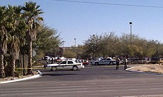 "Emergency officials respond to a shooting involving Rep. Gabrielle Giffords, who was hosting a ""Congress on Your Corner"" event at a Safeway in northwest Tucson, Arizona on January 8, 2010."