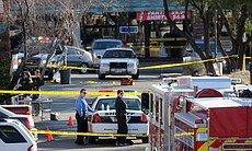 Police quarantine the shopping center where U.S. Rep. Gabrielle Giffords (D-AZ) and several others were shot during an event in front of a Safeway grocery store January 8, 2011 in Tuscon, Arizona. U.S. Rep. Gabrielle Giffords (D-AZ) was shot in the head at a public event entitled 'Congress on your Corner' when a gunman opened fire outside a Safeway grocery store in Tucson, Arizona.
