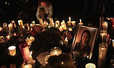Candles surround a portrait of U.S. Rep. Gabrielle Giffords (D-AZ), who was shot January 8, 2011 in Tuscon, Arizona.