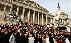 WASHINGTON, DC - JANUARY 10: A crowd including members of Congress and their staff gather on the East Steps of the House of Representatives for a national moment of silence in honor of the victims of Saturday's mass shooting in Tucson, Arizona.