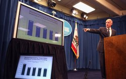 California Governor Jerry Brown points to a chart as he speaks to reporters a...
