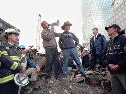 President George W. Bush speaks to rescue workers, firefighters and police officers from the rubble of Ground Zero on Sept. 14, 2001, in New York City.