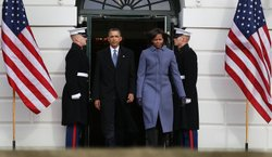 U.S. President Barack Obama and first lady Michele Obama walk up to participate in a moment of silence to honor those killed and wounded during a shooting in Tucson, Arizona on January 10, 2011 in Washington, DC.