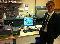 Scripps Institution of Oceanography Professor Ralph Keeling with an instrument in his lab that collects greenhouse gas emission data in San Diego. Keeling is one of the scientists working to deploy a new global GHG emissions monitoring network.