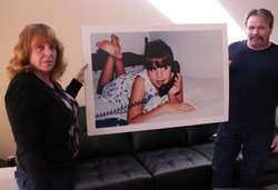 Cheryl and Stephen Crowe hold a photo of their daughter Stephanie, who was mu...